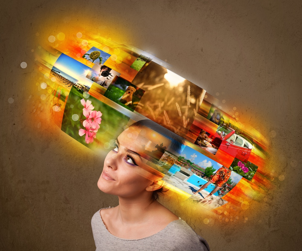 Cute girl with colorful glowing photo memories concept.jpeg