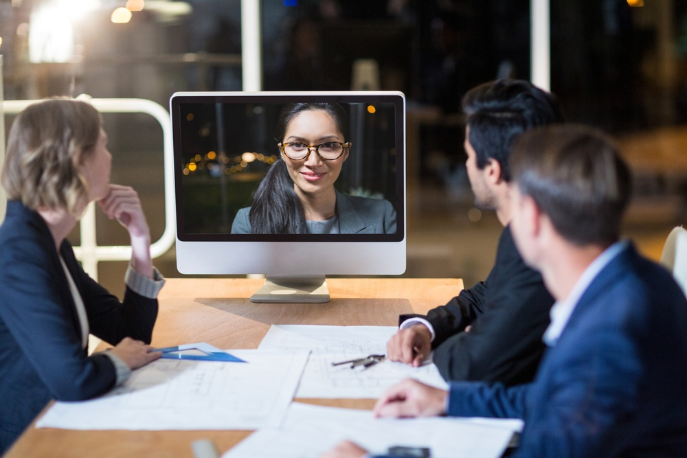Business team having video conference in the conference room.jpeg